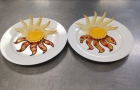 Adv. Pastry: Sunrise Tarts with poached orange slices and tuile.
