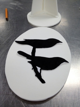 Birds about to be etched in cocoa on pastillage.